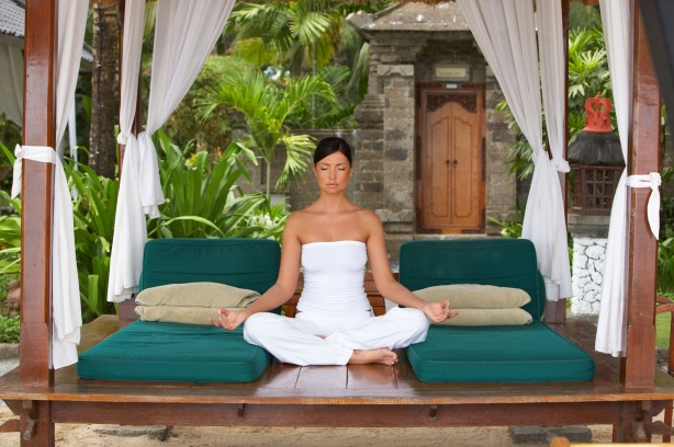 20-25 years woman portrait during yoga at exotic surrounding